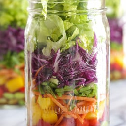 This colorful Asian-inspired salad is layered with edamame, bell peppers, carrots, snow peas, cabbage and lettuce and a simple sesame-soy vinaigrette. One jar is a huge serving, perfect for lunch or it can serve two as a side dish.