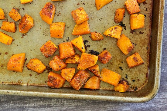 A baking sheet with roasted cubed butternut squash