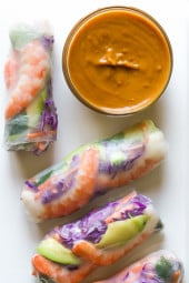 Love the colors in these FRESH homemade Vietnamese style shrimp summer rolls! Accompanied with a peanut hoisin dipping sauce. They are simple to make at home and can be filled with any type of protein and veggies you like.