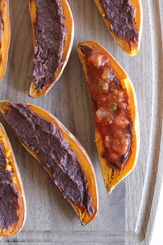 These cheesy baked sweet potato skins are loaded with fat free black refried beans, salsa and cheddar cheese. Just a few ingredients but they taste SO good!