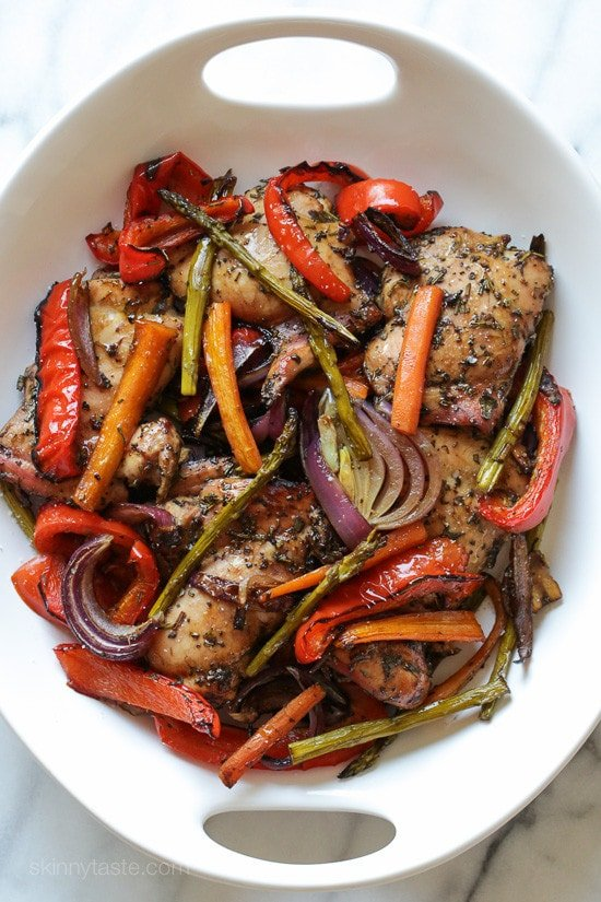 The BEST chicken recipe and one of my most popular! Balsamic Chicken with Roasted Vegetables seasoned with sage, rosemary and balsamic vinegar, then baked in the oven. A delicious healthy meal-in-one! Smart Points: 8 Calories: 401