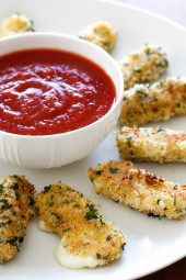 Hot mozzarella sticks – I can't think of a more popular finger food for both kids and adults alike. My oldest daughter Karina LOVES them and these never disappoint! Made lighter with part-skim mozzarella then coated with crispy seasoned breadcrumbs and baked (not fried!) until hot and golden. Serve them with my quick marinara sauce and you have yourself an appetizer everyone will love!