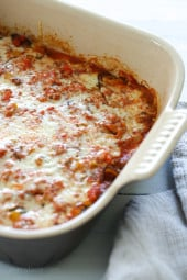 Layers of eggplant, zucchini and squash are baked in a quick tomato sauce with bell peppers and herbs then topped with Havarti cheese. This is a great tasting meatless main dish.
