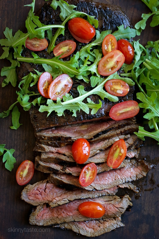 Easy dinner recipe, marinate the steak overnight if you wish then throw it on the grill the next day! Toss it with arugula and tomatoes and dinner is ready in less than 20 minutes!