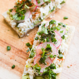 Fresh crab, sliced radishes, lime, paprika and cilantro elevate simple avocado toast to a whole new and delicious level!