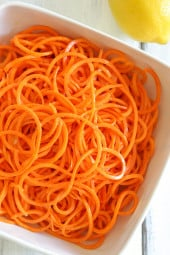 An easy 5-ingredient carrot salad that is lemony, bright and delicious! You don't need a spiralizer to make it, you can use pre-shredded carrots or use a potato peeler to cut the carrots into ribbons.
