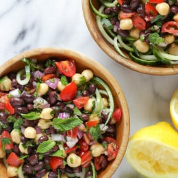 This Mediterranean Bean Salad is so light and fresh, made with lemon juice, mint and parsley. This can be served as a side dish, perfect for potlucks or to make it a main for lunch serve it over spiralized cucumbers.
