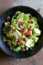 This shredded raw brussels sprout salad with bacon and avocado can be eaten as a main or a side dish. Because raw brussels stand up so well to dressing, it's also great to make ahead – just add the avocado right before serving.