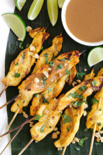 These easy, flavorful Thai inspired chicken skewers are marinated in coconut milk and spices, then grilled and served with a delicious spicy peanut sauce for dipping.
