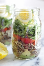 A protein-packed meatless salad in a jar made with quinoa, lentils, grape tomatoes, arugula, avocado and hard boiled eggs are perfect to pack for work, the beach, picnics, or anywhere you need a portable lunch on-the-go!