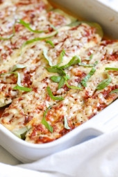 Hollowed out zucchini boats stuffed with a veggie lasagna filling, all baked in the oven with melted cheese – YUM!