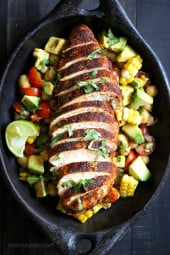 Spice rubbed chicken breasts served with a flavorful chickpea salad with fresh corn and avocados – a quick and easy weeknight dish!