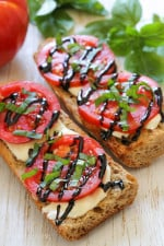 I've been taking advantage of the tomatoes and basil overflowing from my garden with these simple French bread pizzas. Only 5 ingredients, less than 10 minutes to make! Have them for lunch or dinner paired with a side salad.