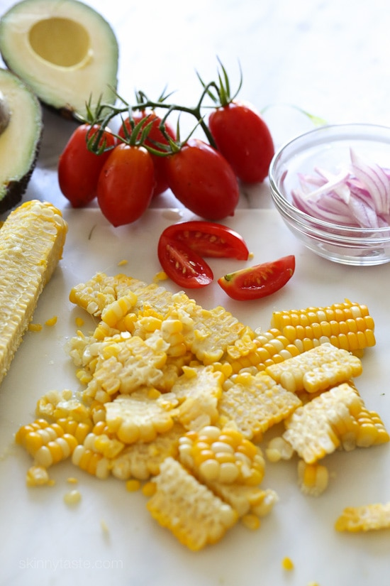 Take advantage of the end of summer with sweet corn and delicious ripe tomatoes with this easy side dish, perfect to go along anything you 're grilling! The dressing is creamy yet light, the perfect compliment.