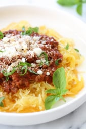 Make meat sauce AND Spaghetti Squash at the same time with this delicious one-pot meal ready in under thirty minutes (if using a pressure cooker)!