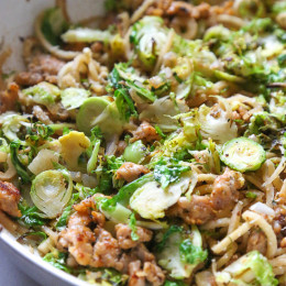 Spiralized parsnips make a wonderful pasta replacement in this satisfying, spicy Autumn dish made with brussels sprouts and spicy chicken sausage.