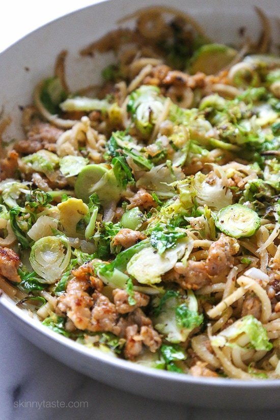Spiralized parsnips make a wonderful pasta replacement in this spicy Autumn dish made with brussels sprouts and spicy chicken sausage.