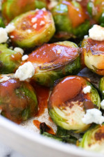 These Brussels sprouts start in the skillet and finish in the oven for perfectly charred edges, then drizzled with buffalo hot sauce and crumbled blue cheese – SO good!!