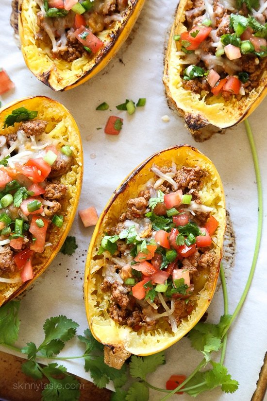 These Turkey Taco Spaghetti Squash Boats are my favorite way to eat spaghetti squash! Filled with the most flavorful turkey taco meat, cheese and topped with pico de gallo. #lowcarb #keto #whole30 #glutenfree #spaghettisquash #spaghettisquashrecipe