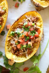 These are my favorite new way to eat spaghetti squash! Filled with the most flavorful turkey taco meat, cheese and topped with pico de gallo.