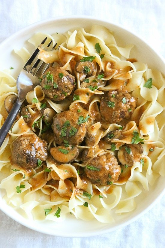 Comfort food the whole family will love! These delicious turkey meatballs are simmered in a sour cream mushroom sauce, SO good! Perfect over egg noodles or serve them over spiralized butternut squash noodles if you want to lower the carbs.