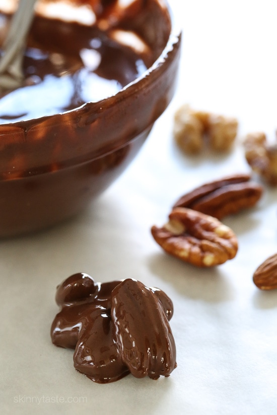 Almonds, pecans and walnuts are dipped in dark melted chocolate and finished with a touch of sea salt for the tastiest Holiday treats!