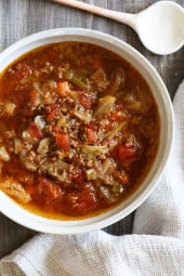 I love this cabbage soup recipe, made with ground beef, vegetables and tomatoes. It's the perfect cold weather soup and makes enough for leftovers.