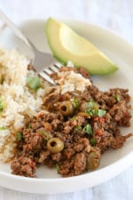 Picadillo is the most requested dish by my kids and it's so easy to make. We love it served over brown rice (or cauliflower rice) with this quick cabbage slaw or a salad on the side.