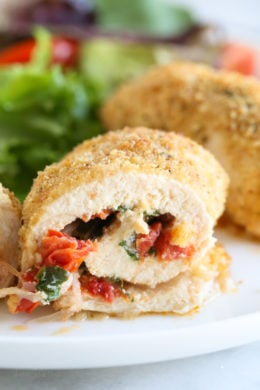 Chicken breasts stuffed with Sun Dried Tomato Bruschetta, mozzarella and spinach rolled, breaded and baked in the oven. Easy to make, and the chicken comes out so juicy!