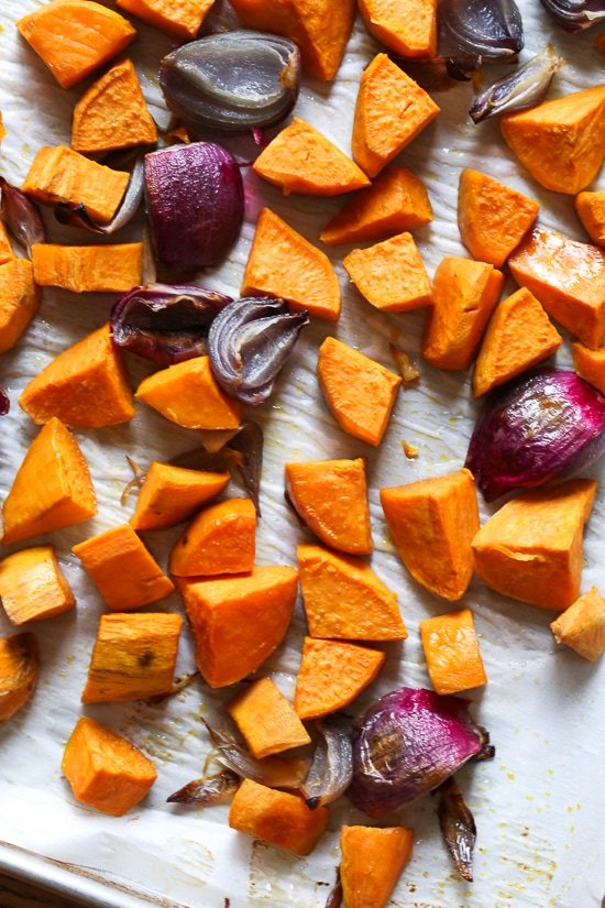 Roasted sweet potatoes are magical in this soup when combined with a squeeze of lime juice. The crushed macadamia nuts on top add texture in every bite!