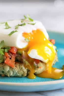 Traditional Eggs Benedict are made with Hollandaise sauce, but I prefer to skip the Hollandaise which shaves off about 200 calories, the egg yolks are perfectly silky on their own!