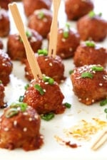 These Asian inspired turkey meatballs are seasoned with ginger and spices and finished with a sweet and spicy, gochujang glaze. Great as an appetizer or serve them with brown rice to make them a meal.