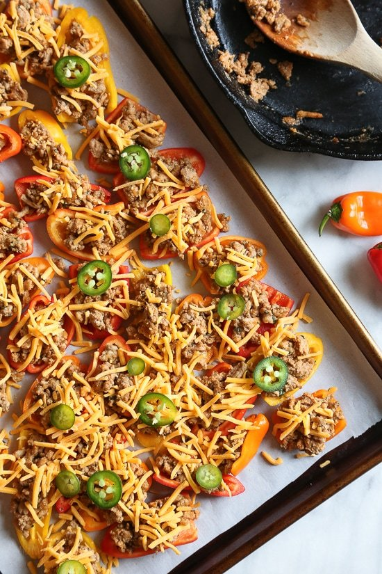 Loaded mini bell pepper nachos – game changer!! These low-carb nachos are loaded with turkey taco meat, cheese and all your favorite nacho toppings!