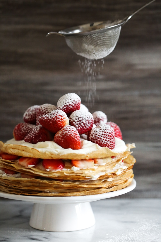 Crepes are not just for scrolling, something special happens to you then layer with cream and top them with strawberries. It creates a beautiful cake-like dessert, when you slice into it, you can see all the layers.