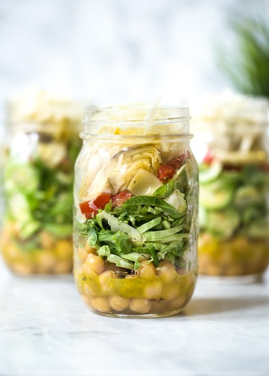 Raw Brussels Sprouts and Chick Pea Salad in a Jar with Artichokes, Sun Dried Tomatoes and Asiago