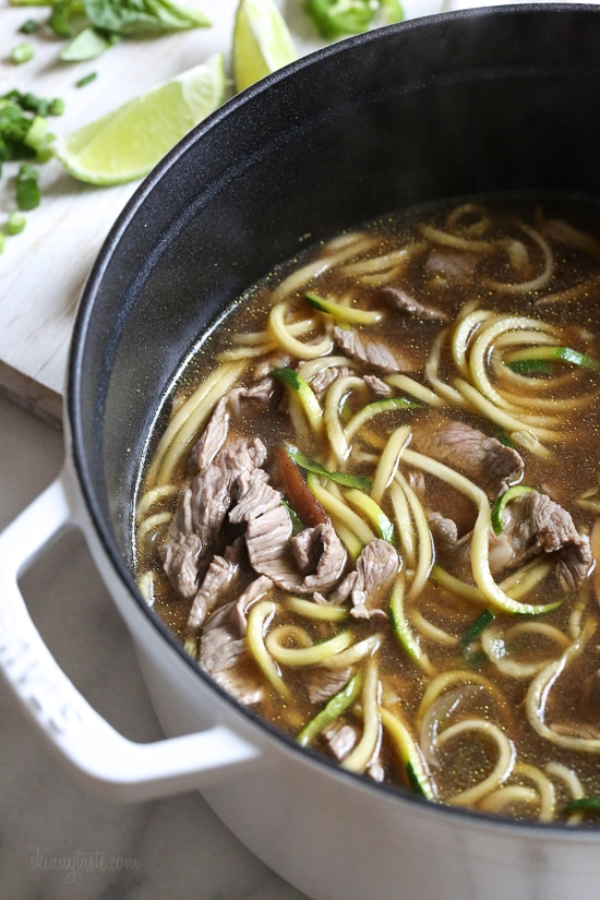 A quick, flavorful Vietnamese-inspired nood-less pho subs zucchini for rice noodles. So easy, the steak is sliced thin and cooks less than a minute in the ginger-garlic beef broth. Top this with fresh lime, basil, cilantro, jalapeno and scallions and you have one tasty faux pho!