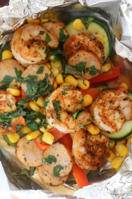 Cajun Shrimp foil packets are so easy to make, anyone can do it! Spicy shrimp seasoned with Cajun spices, Andouille sausage, and rainbow colored vegetables are baked together in foil pouches. They are fast and easy to make, and can be made ahead and kept in your freezer. When you're ready to cook them, just pop them in the oven – perfect for busy weeknights!