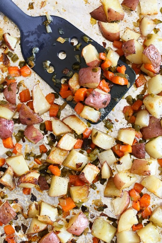 Homemade breakfast potatoes made with red potatoes, onions, bell pepper and carrots all on one sheet pan. All you need is some eggs and breakfast is served!