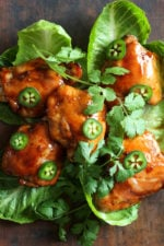 Sweet and spicy, these juicy skinless tamarind-glazed chicken thighs are easy to make and are perfect served with crisp lettuce on the side.