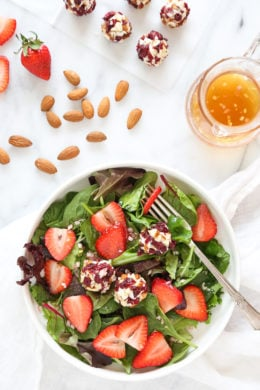 This beautiful Spring Berry Salad with Almond-Cranberry Crusted Goat Cheese is studded with strawberries and served over baby greens, but you can use any seasonal berries or a combination of berries instead. Serve this salad alone or alongside grilled chicken or fish.