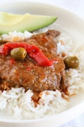 Braised Cubed Steak with Peppers, Onions and Olives is a flavorful, cheap, family-friendly dish you can make in the Instant Pot, Slow Cooker or stove-top.
