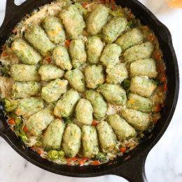 Skillet Chicken and Broccoli Veggie Tot Pie is the ultimate fast and easy, family-friendly, one-pan comfort dish! Made in a skillet with chicken breast, celery, carrots, and broccoli, then finished in the oven with broccoli and cheese veggie tots.
