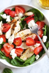 Grilled Chicken Salad with Strawberries and Spinach is made with creamy goat cheese and a white balsamic dressing, but this would also be great with Feta cheese and if you want to add more protein, or skip the cheese add walnuts or slivered almonds.