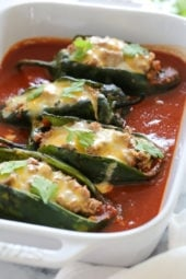 These baked Turkey Enchilada Stuffed Poblanos Rellenos are peppers stuffed with a flavorful ground turkey filling, topped with my homemade enchilada sauce and cheese.