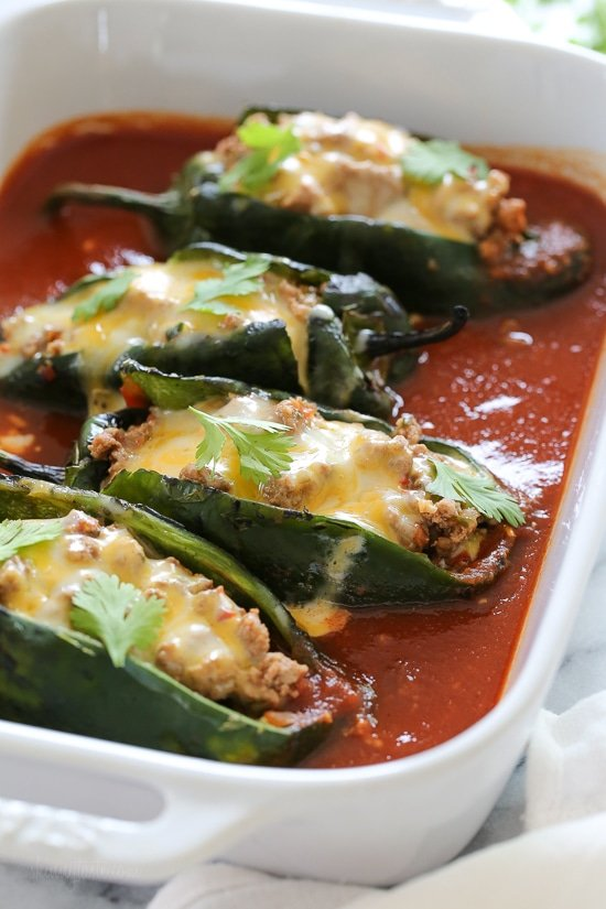 These Baked Turkey Enchilada Stuffed Poblanos Rellenos Are With A Flavorful Ground Filling