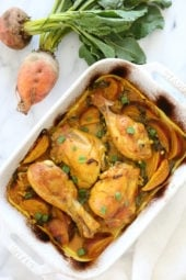 Turmeric Braised Chicken with Golden Beets and Leeks is a flavorful dish layered with vegetables and spices, covered with wine and baked in a casserole dish.