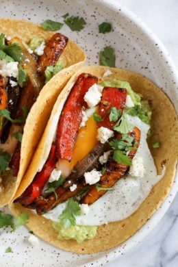 I just love tacos with eggs, and these breakfast fajitas are no exception. Loaded with peppers and onions, guacamole and a runny egg on top (you can prepare the eggs however you like).