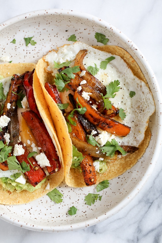 I just love tacos with eggs, and these breakfast fajitas are no exception. Filled with peppers and onions, guacamole and a runny egg on top (you can cook the eggs any way you like).