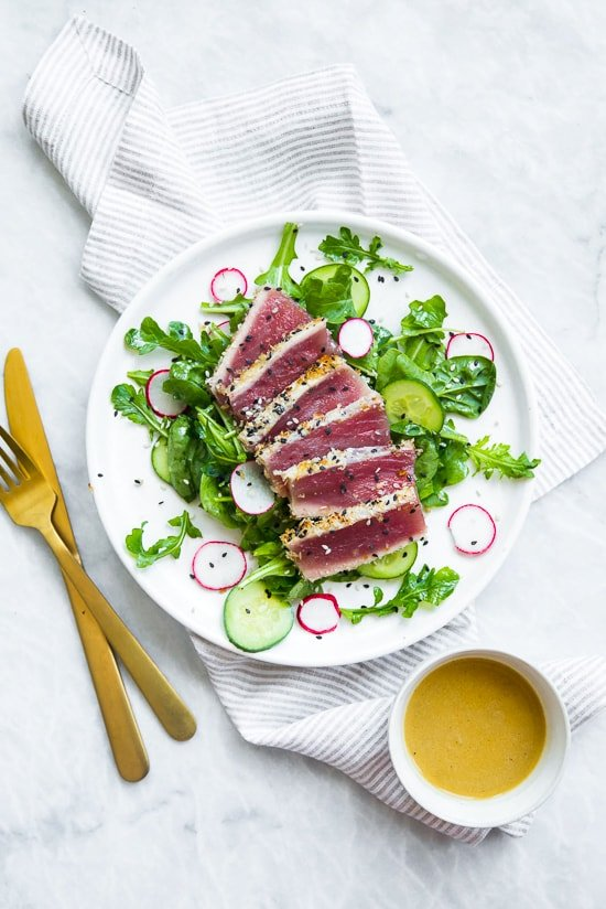 This panko and sesame crusted seared tuna on a bed of arugula and spinach salad, all topped with a wasabi butter sauce, takes Japanese food to whole new level!