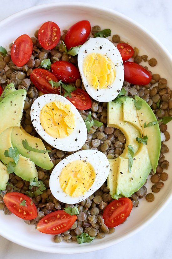 Lentils with hard boiled eggs, tomatoes, avocado, a squeeze of lime juice, cilantro and a few dashes of hot sauce is a really simple meatless lunch I like to make for myself anytime I have cooked lentils (or sometimes I buy them cooked).